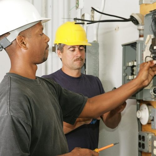 2 electricians working